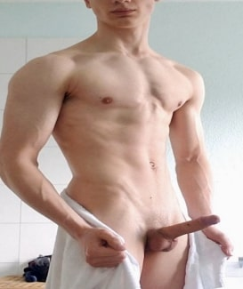 Boy showing erected dick