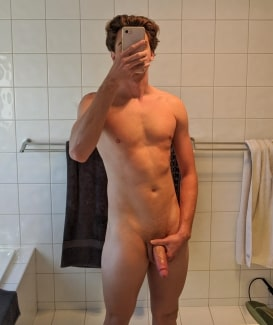 Nude guy taking a selfie
