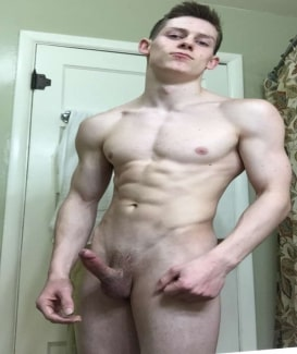 Nude muscle boy with erection